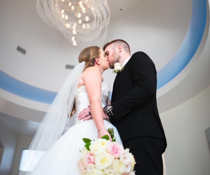 Wedding kiss at the Falls Event Center Gilbert